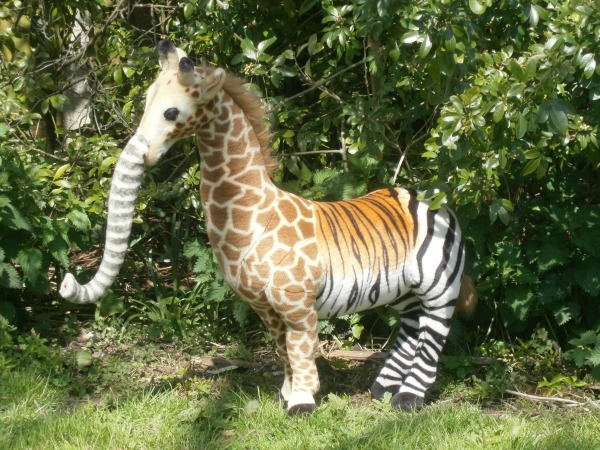 Stuffed toy made up of parts of elephant, giraffe, zebra and tiger
