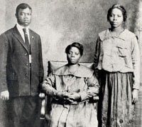 Young Louis Armstrong with his mother and sister.