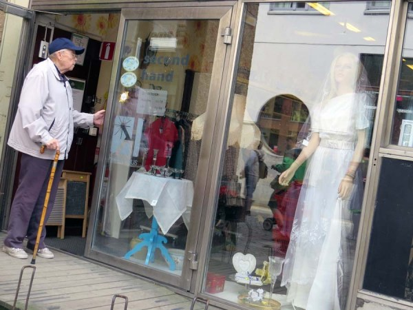 Man stood outside bric-a-brac shop