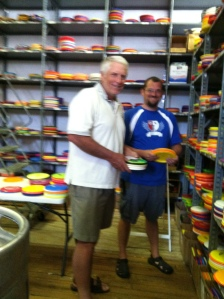 "One of Doug's favorite Kansas City sites. A disc golf shop downtown. The photo's a bit blurry but the expression on his face says, ""I've found Paradise."""