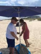 Wilmington on the beach taking down the umbrella