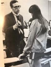 Mr. Landes intent on a student.